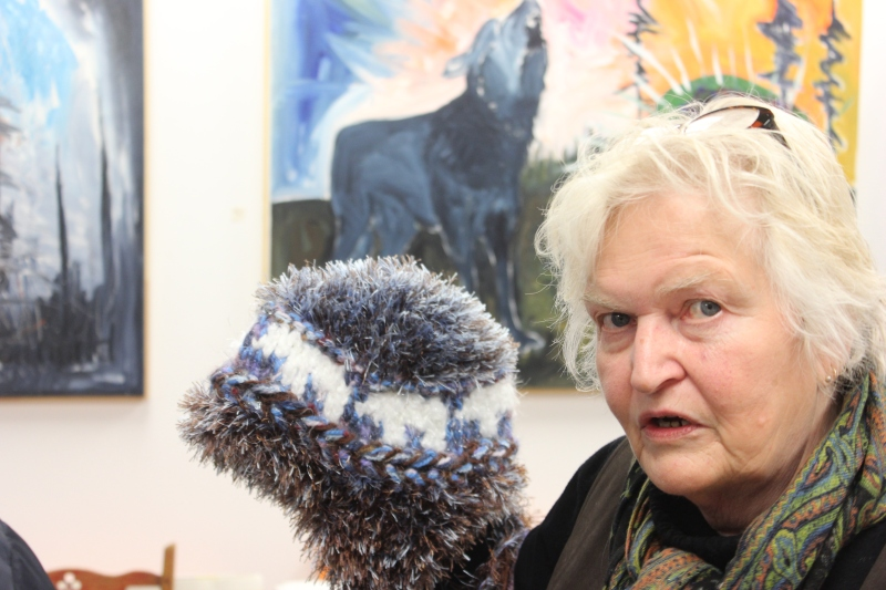 Artist Gunhild Hotte with one of her hand-crafted Polar Bear hats.